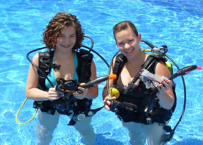 Scuba diving together in the pool with A Water Odyssey Scuba